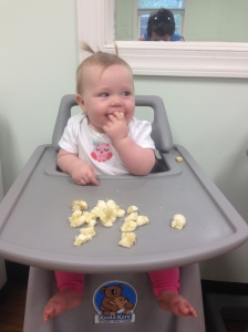 Lydia eating a banana at VBS