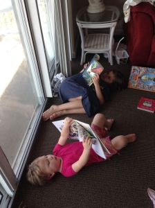 Annie loves to read and its even better with cousins!